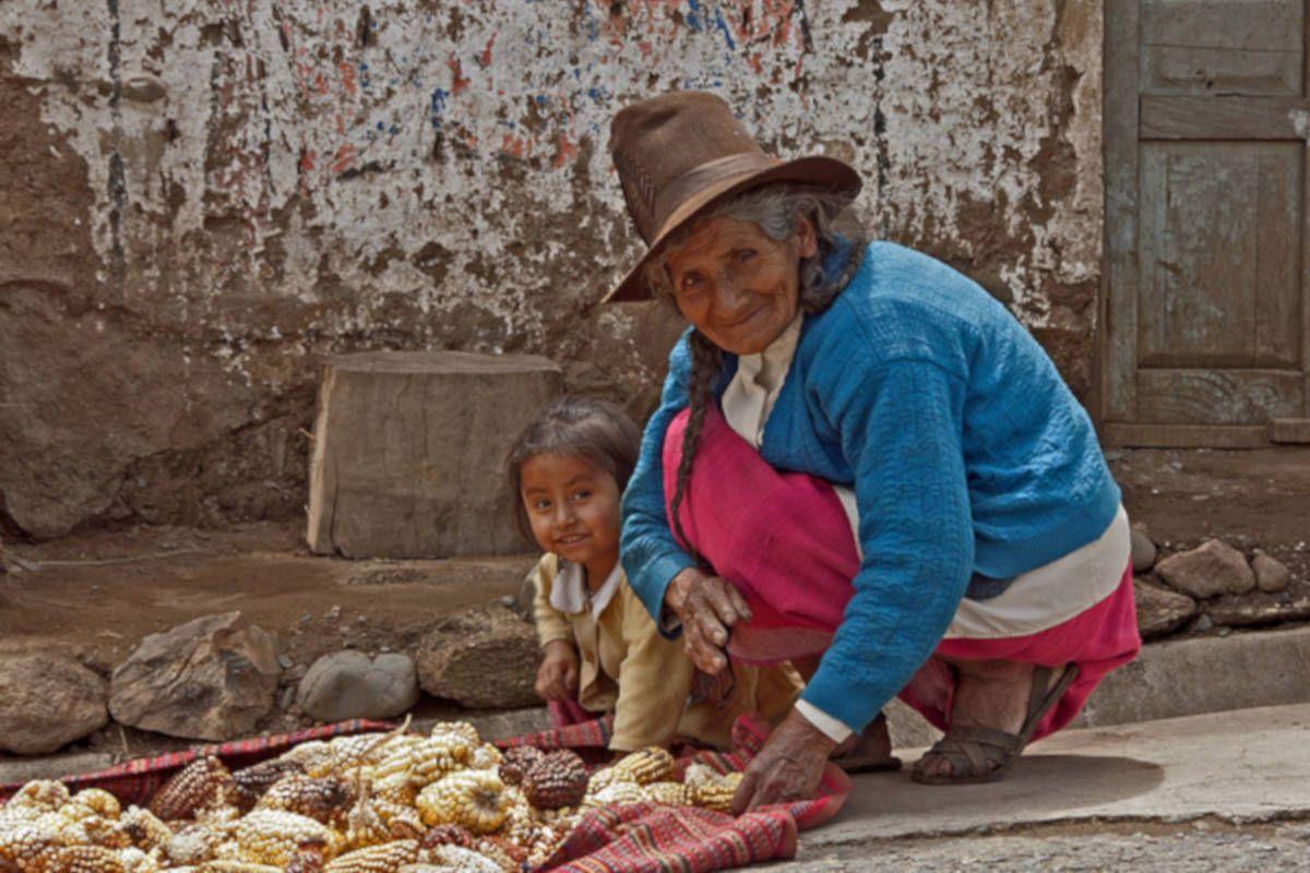 Woman selling corn in Peru